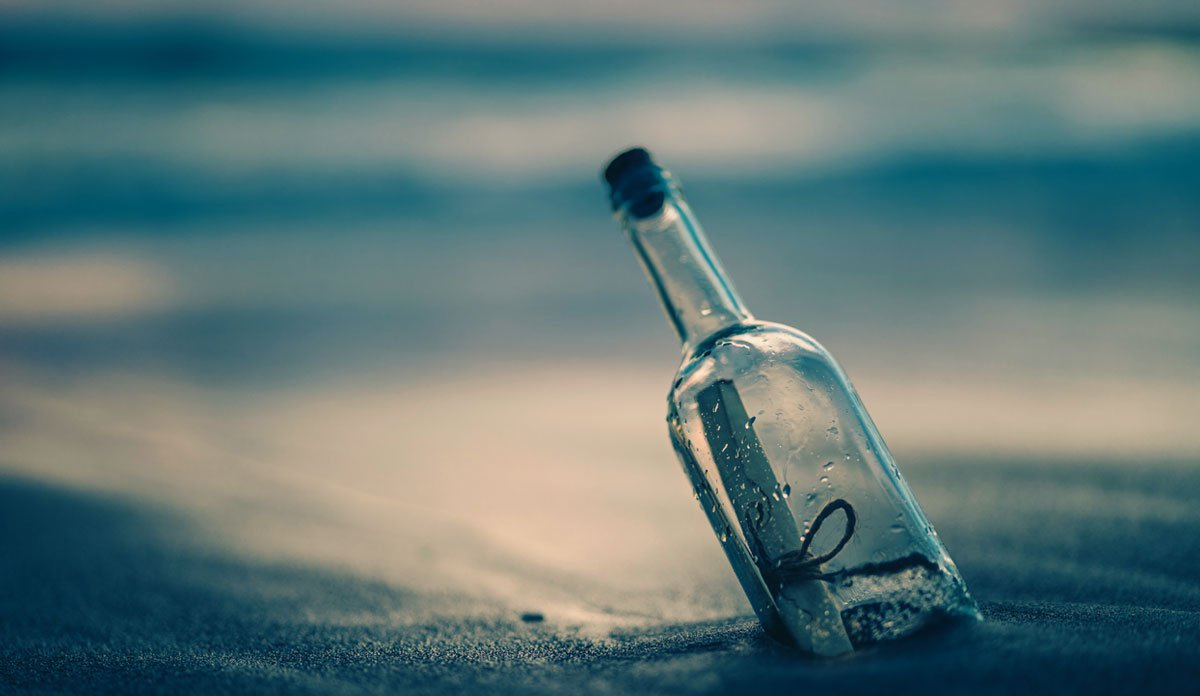 A bottle that has washed up on shore.